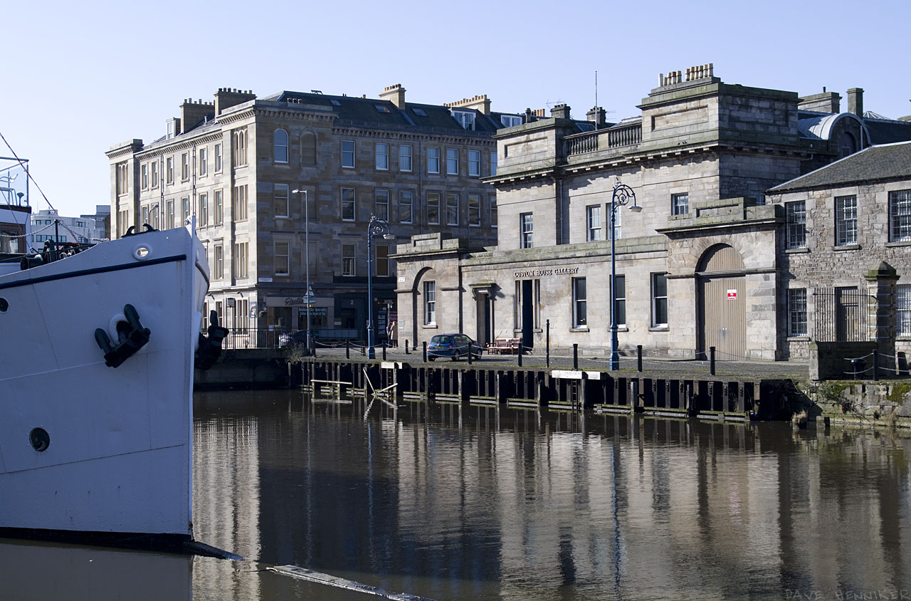 Looking past the bow of the floating restaurant towards Customs House (now a gallery). The corner of Commercial Wharf and Commercial Street can be seen.