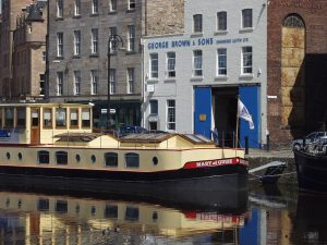 The George Brown & Sons building - and the Mary of Guise boat tied up next to it. The cool colours of the building are complemented by the warm colours of the boat.