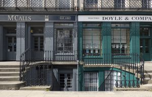 Another example of these appealing shopfronts. Unlike iron railings elsewhere, these weren't chopped down for the Second World War effort.