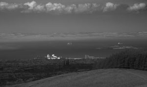 Same standpoint but I used my infrared camera and zoomed in on Leith. The patch of sunshine drifted a bit to the left, leaving the flourmill in shade. Western Harbour is still sunny.