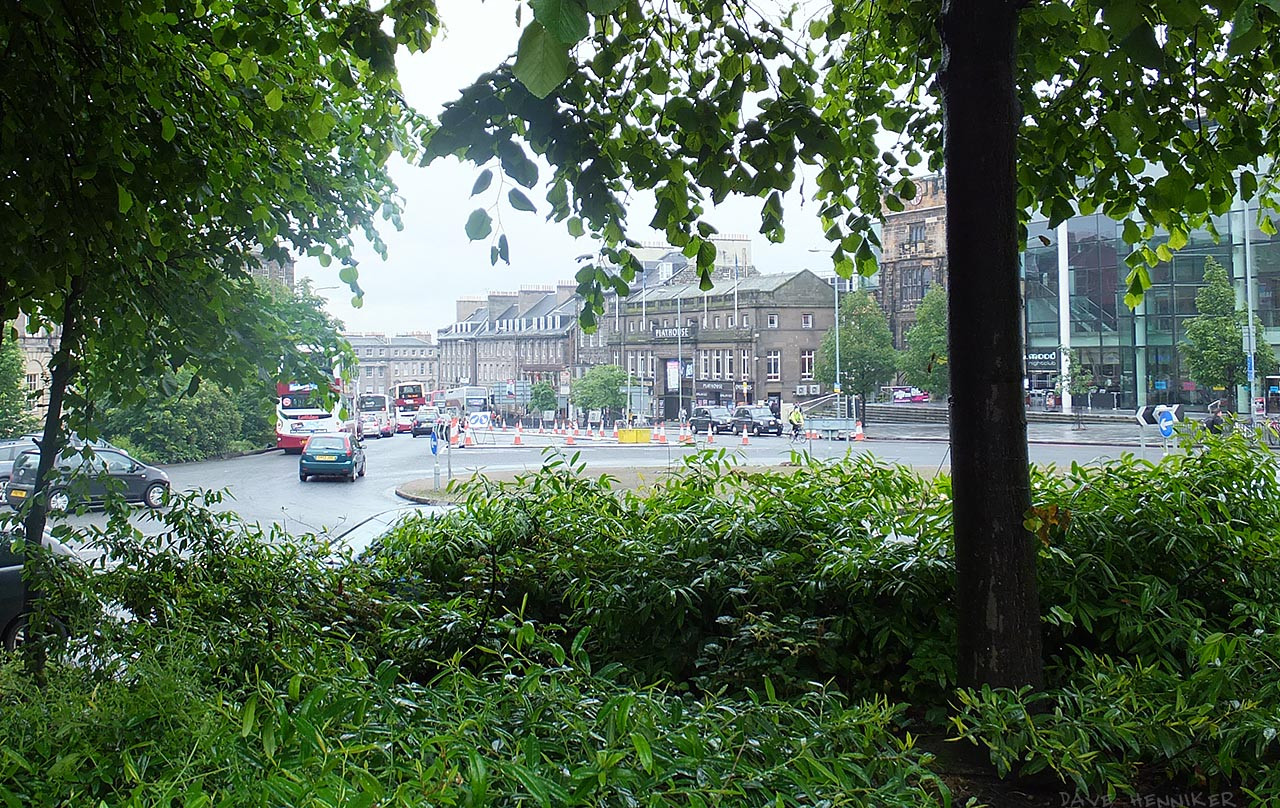 Peering through the trees across the roundabout. Straight ahead is the Playhouse theatre.