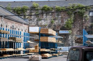 There's a timber business apparently thriving like the back wall of the yard, where nature is thriving and will destroy the building if the demolition men don't get there first.