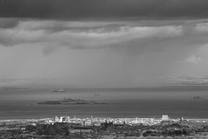 In this smaller picture Inchkeith Island is left of centre. In front of that can be seen Edinburgh Castle's Esplanade and the grassy slope (light grey) leading down to Johnson Terrace. (These infrared photos were taken from Capelaw in the Pentland Hills.)