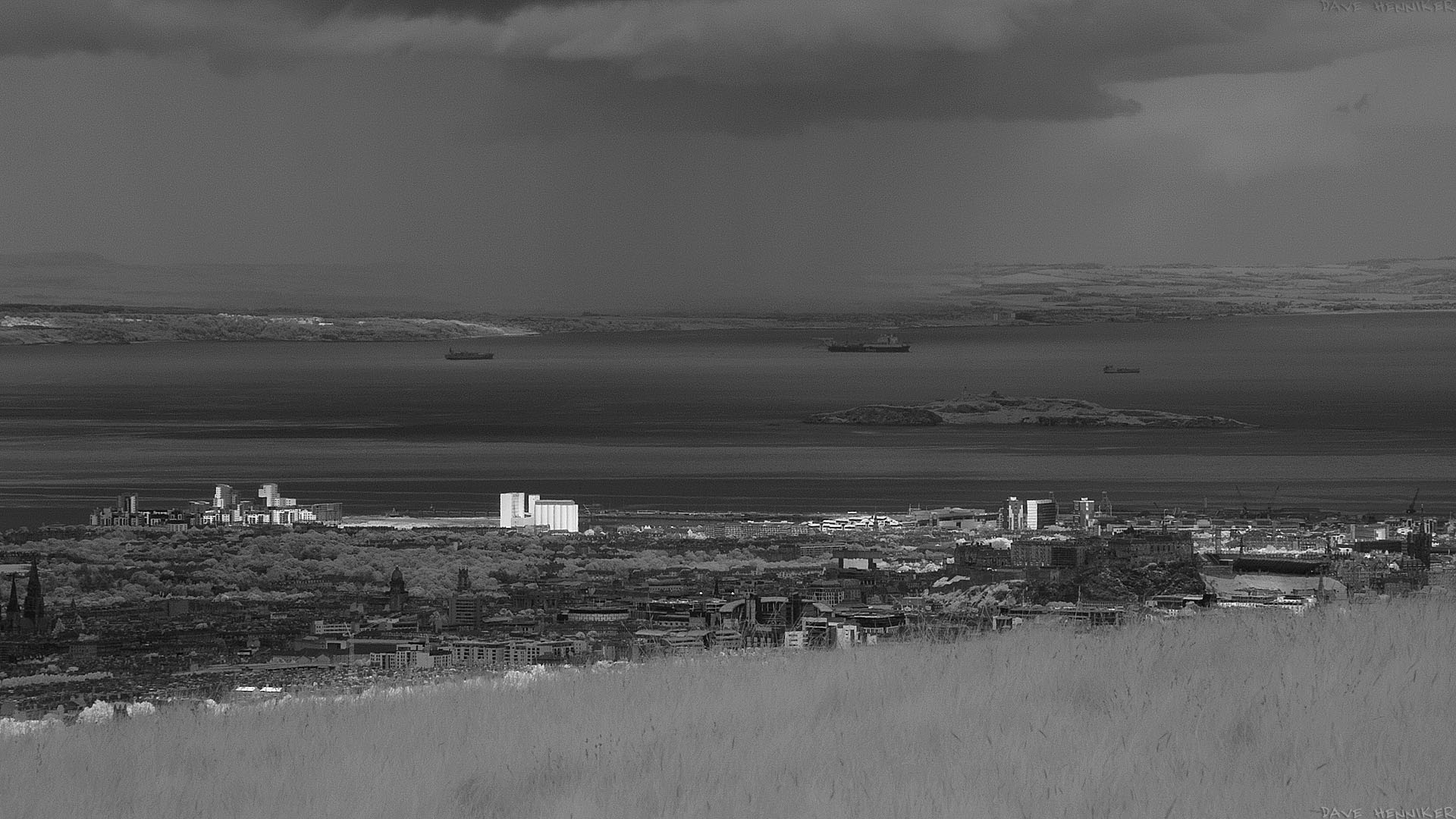 Sunny Leith! This large, wallpaper-sized infrared photo features Western Harbour, the Chancelot Flour Mill, Ocean Terminal, Persevere Court and Citadel Court in the sunshine. In the gloomier parts of the picture various Edinburgh landmarks are visible including Edinburgh Castle. It's raining in Fife.