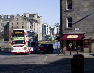 Henderson Street ends here at Tolbooth Wynd. To the left is Sheriff Brae and Sandport Place bridge. The 16 bus continues along Shore before turning left over the Water of Leith and into Commecial Street.