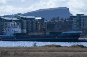 Zoomed in more for a closer look at the ship Hekla. On top of Salisbury Crags can be seen some walkers, only about 5 pixels high in this photo.
