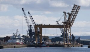 As well as 3 cranes there are what appears to be 2 gantries on the right which, when lowered, provide aerial walkways.
