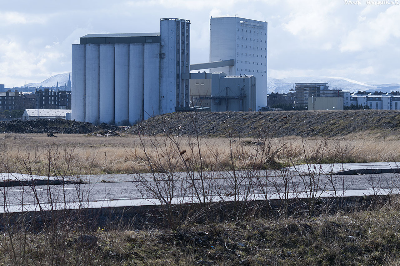 Looking back across the roadway in the previous picture towards Chancelot Flour Mill. The snowy Pentland Hills can be seen 12km away.