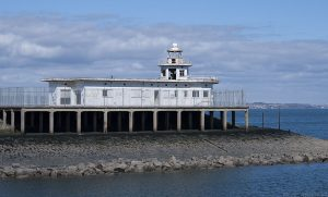 A fence surrounds the old lighthouse to keep the glue-sniffers and scribblers out.