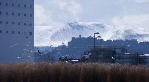 The first of three pictures showing Edinburgh Castle with the snowy Pentland Hills in the background.