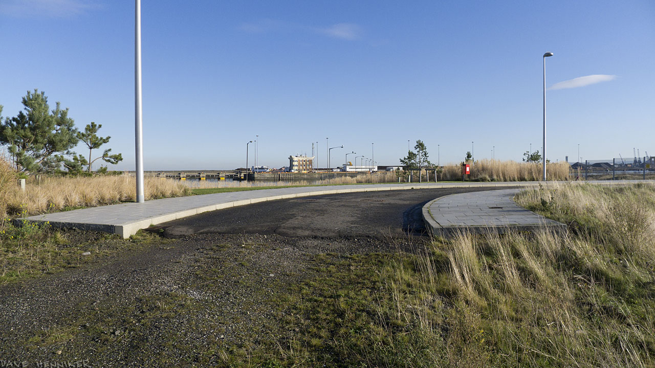 A street curves round a bend and stops abruptly.