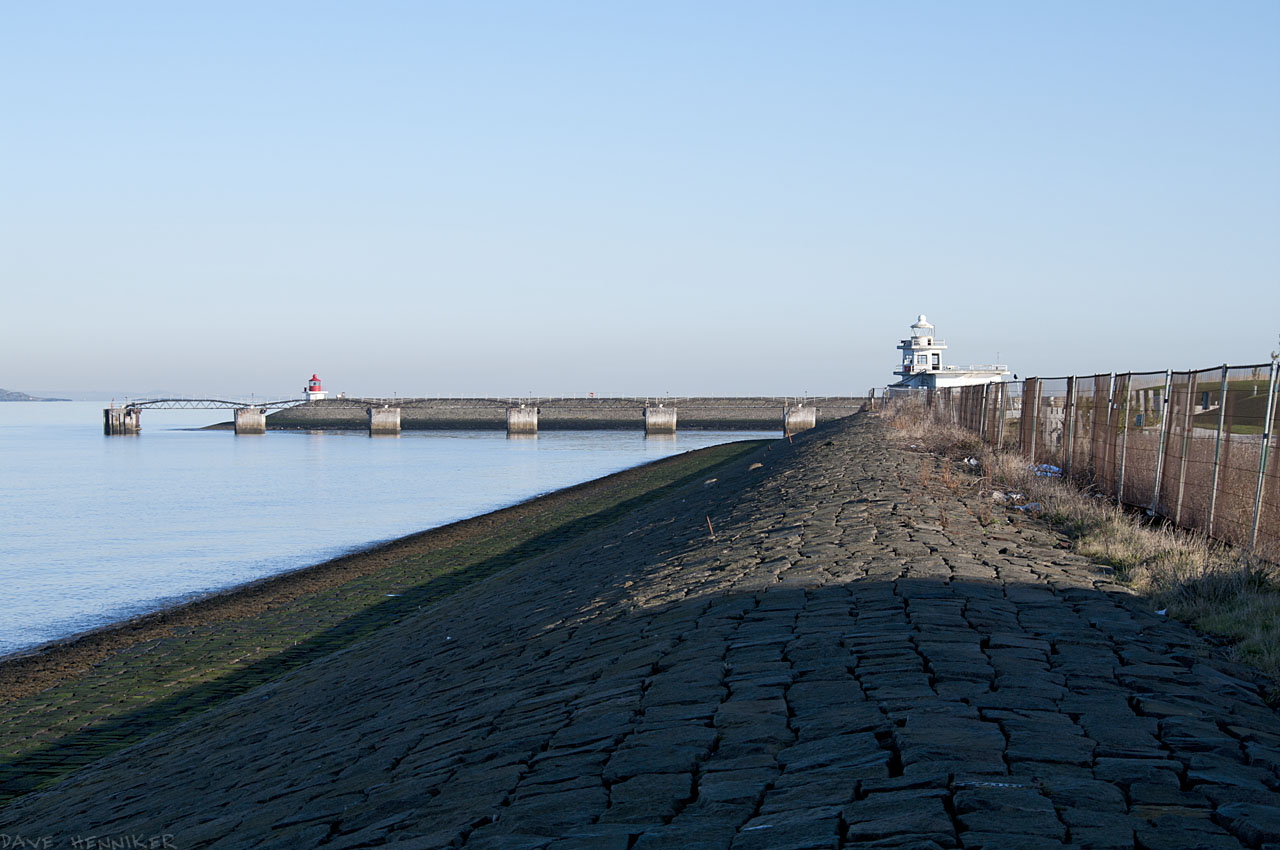 The approach along the sea wall towards the seaward entrance to the Port of Leith.