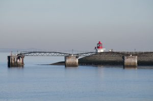 The little red building is at the northernmost point of Leith or Edinburgh (unless you include Cramond Island). Incoming vessels must wait beside the pier for lock gates to be opened.