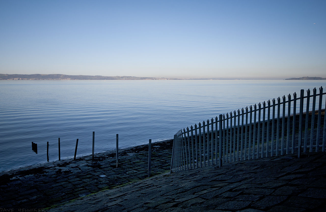 Presumably the fence once provided a barrier at low tide as well. Steel fences tend to suffer when submerged by salt water twice daily.