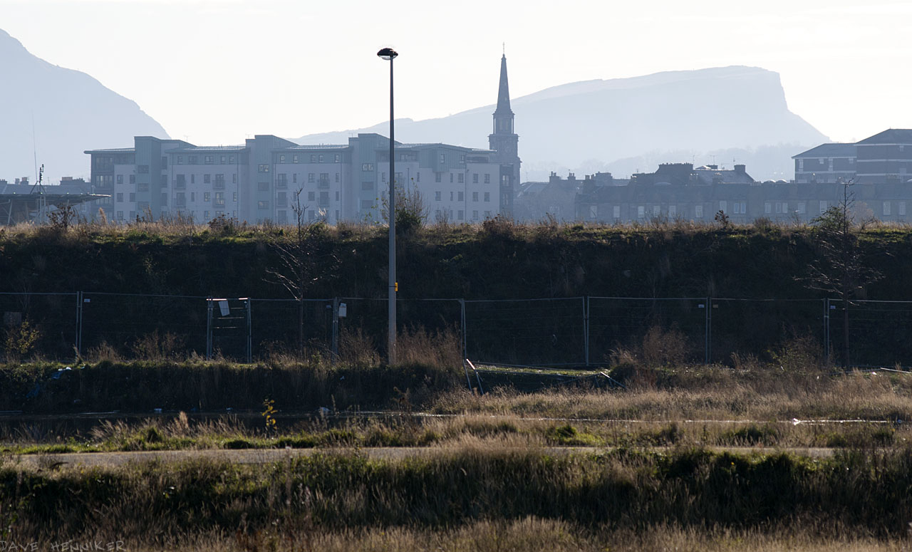 Looking across towards Leith with Salisbury Crags in the distance.