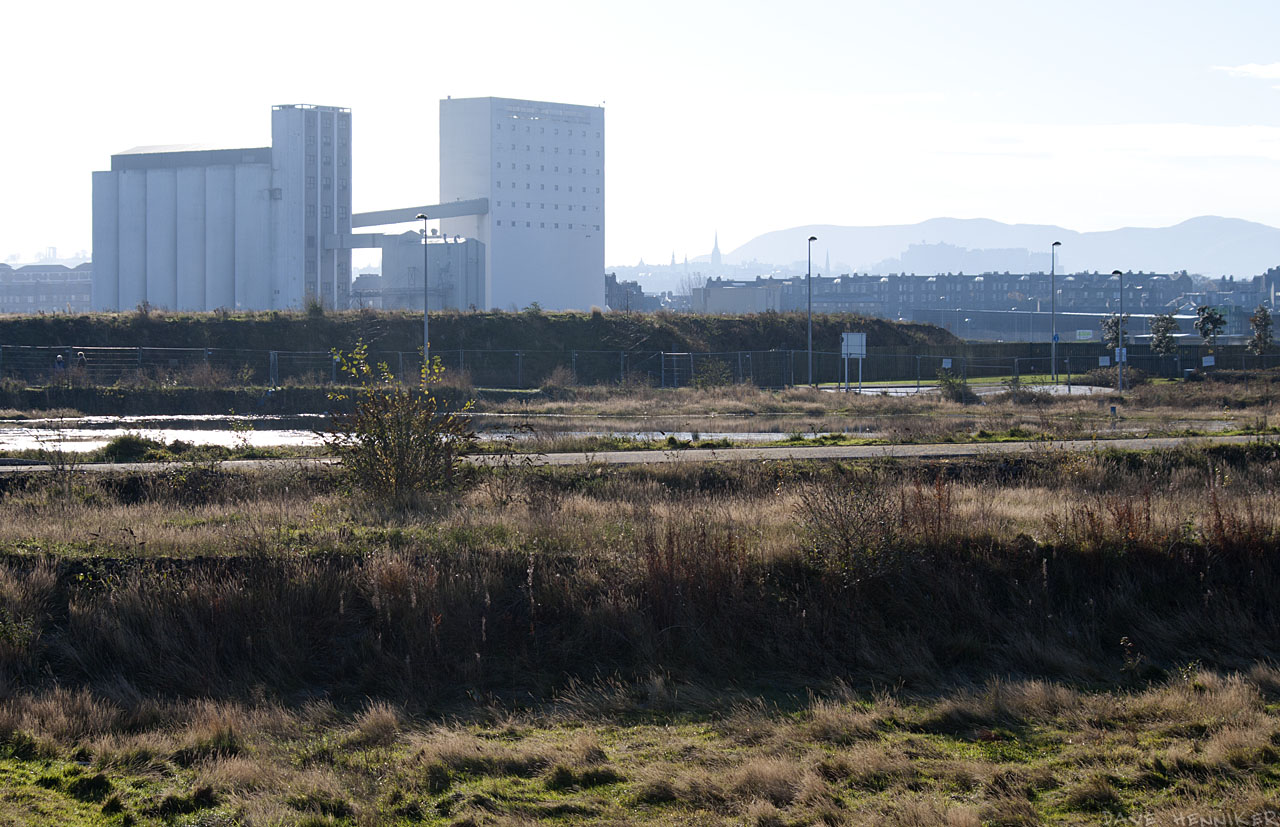 On the left, Chancelot Flour Mill. On the right are the characteristic shapes of the Pentland Hills and Edinbugh Castle.