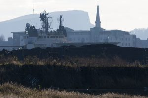 Mud, water, an ocean-going ship and Salisbury Crags.