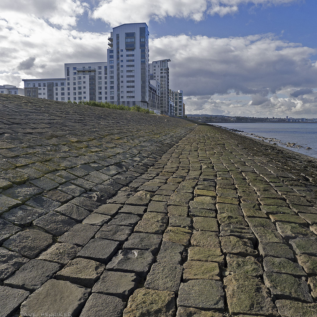 Looking back at the flats from further out on the sea wall.