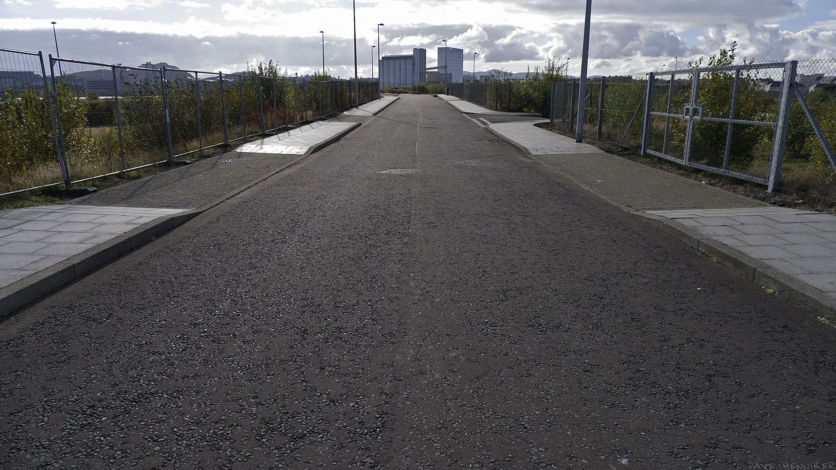Still currently 'the road to nowhere'. Straight ahead is that flourmill again. The profile of Arthur's Seat and Salisbury Crags is on the left horizon.