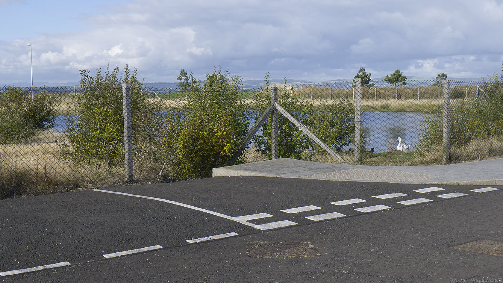 The same redundant road junction as above but with the camera panned to the right to reveal the pond with ducks and swans.
