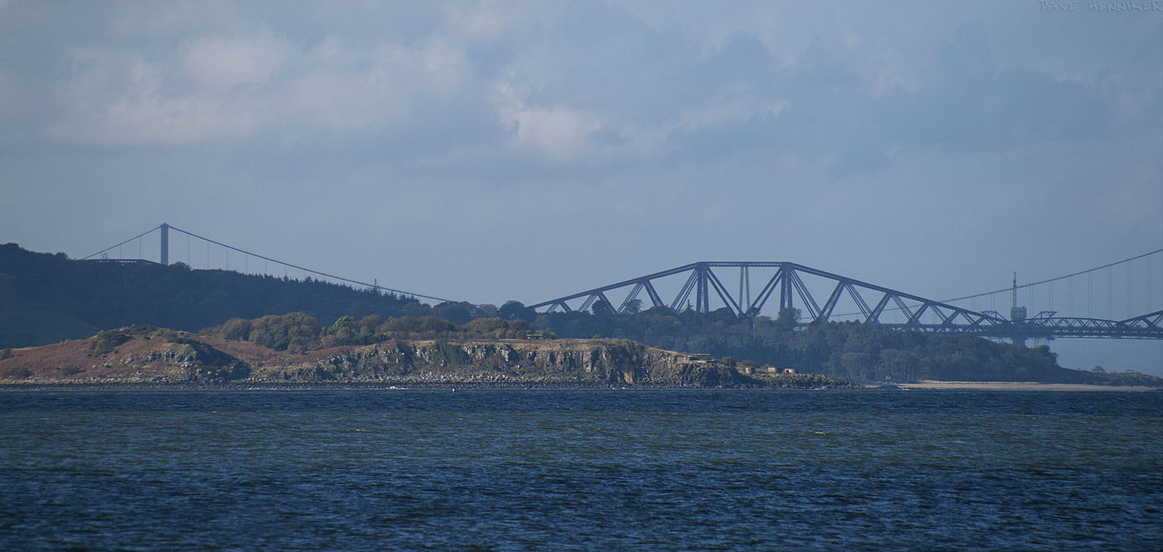 A long lens shot looking west towards Cramond Island and the Forth bridges (two and a bit). (Cramond Island is 4 miles away and the Forth Bridge is 8 miles away.)