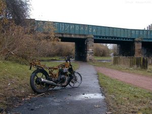 A stone's throw from the Royal Yacht Britannia is this desolate scene with a burnt-out motorbike on the cycle path near Lindsay Road and Anchorfield.
