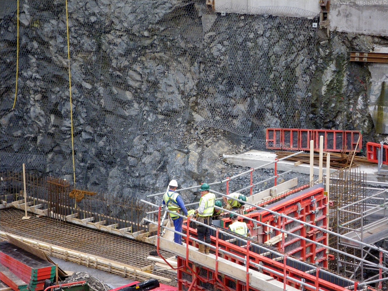 Wire mesh is fastened to the rock face to support any crumbling lumps which might otherwise fall down.