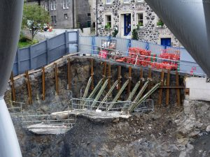 This shows the measures taken to prop up the street, perching, as it now does, on top of a cliff cut into the crumbling rock.
