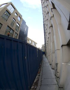 At the top of this narrow passageway are the old houses, at least one of which has had its view totally cut off.