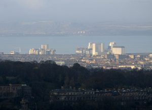 Photographed from Salisbury Crags, looking over the top of shady Calton Hill.