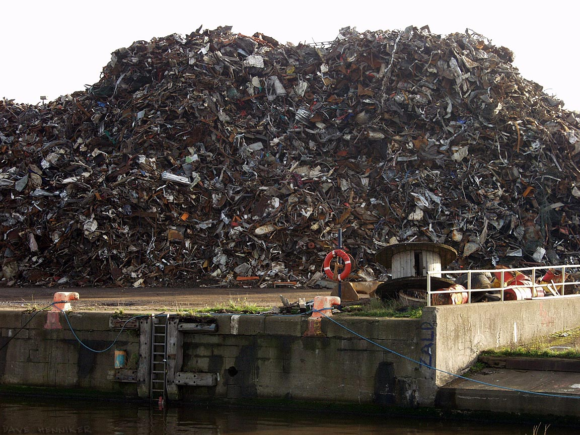 A heap of trash on the dockside, origin and destination unknown. The metal content will probably be recycled.