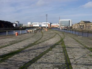 A few yards further south, nearer to Ocean Drive is this view west towards the Ocean Terminal building. Moss now grows in amongst the railway lines and stone setts.