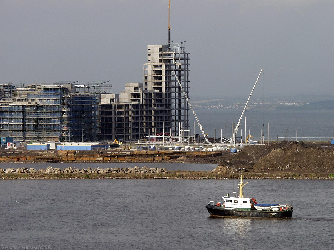 The apartment buildings across the harbour will have fabulous views of the sea-going traffic and the landscapes beyond. In this picture the town of Dalgety Bay is visible through the haze on the Firth of Forth.
