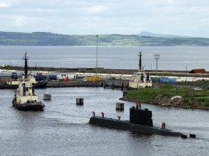 The 7th floor of the carpark provides this view of the submarine and tug. We can see over the Firth of Forth to Kinghorn and its caravan site on the side of a hill.