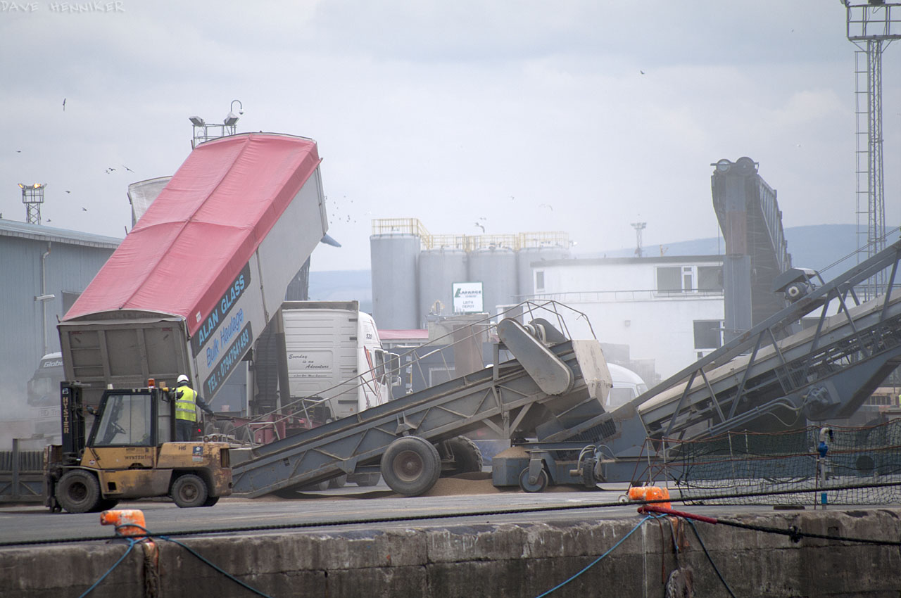 Closer inspection suggests it's loading some kind of grain for export overseas.