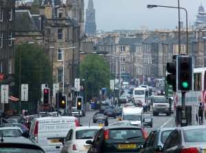 'I [heart] Leith' say a succession of signs fixed to lamp posts. Two long lens shots show the traffic going up and down Leith Walk past all the restaurants and specialised shops, some of which have been photographed by David Byrne from Talking Heads.
