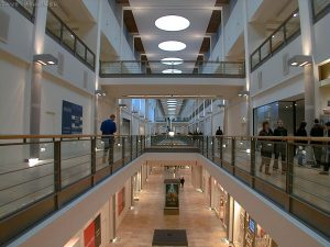 Inside the building everything is pristine and most of the shops are still unoccupied. Once it fills up a bit, the ambient noise will hopefully lose some of its unpleasant reverberation. This is the first of three views up the centre of the mall.
