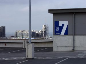 This sign removes any doubt as to which level of the car park you're on. Shining in the sunlight on the other side of Western Harbour are nascent waterfront buildings which will further transform this whole area.
