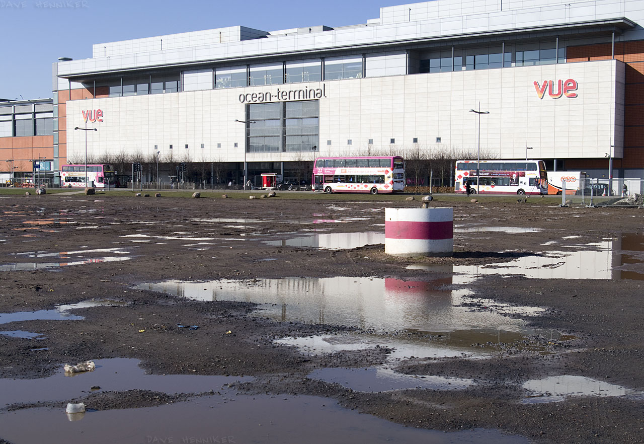 Ocean Terminal has become more attractive these days with good shops. The area in front remains empty except for puddles and strange red and white striped pipe things.