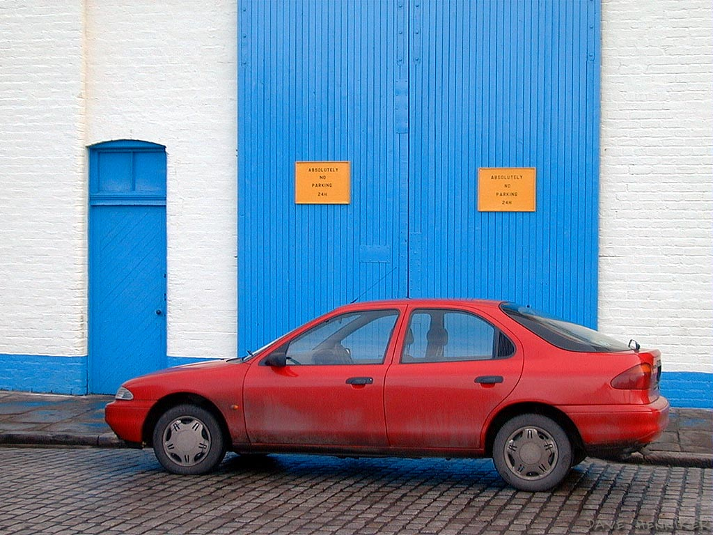Contrasting, almost primary colours here. The driver is either a worker here or else he failed to read the ABSOLUTELY NO PARKING 24H signs.