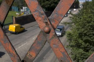 climbing the steps onto the bridge affords views. This shot shows Seafield Road through the rusty ironwork.