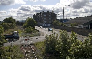 This is the view east from the bridge, showing the rail crossing and the tenements at the corner of Seafield Street - which leads to the Eastern General Hospital.