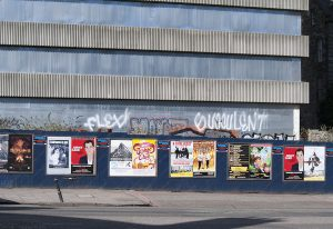 Behind the posters advertising Jimmy Carr and the new Bongo Club, an adolescent male has shown his spelling skills and his like for plants with fleshy leaves. The old Bongo Club was in New Street.