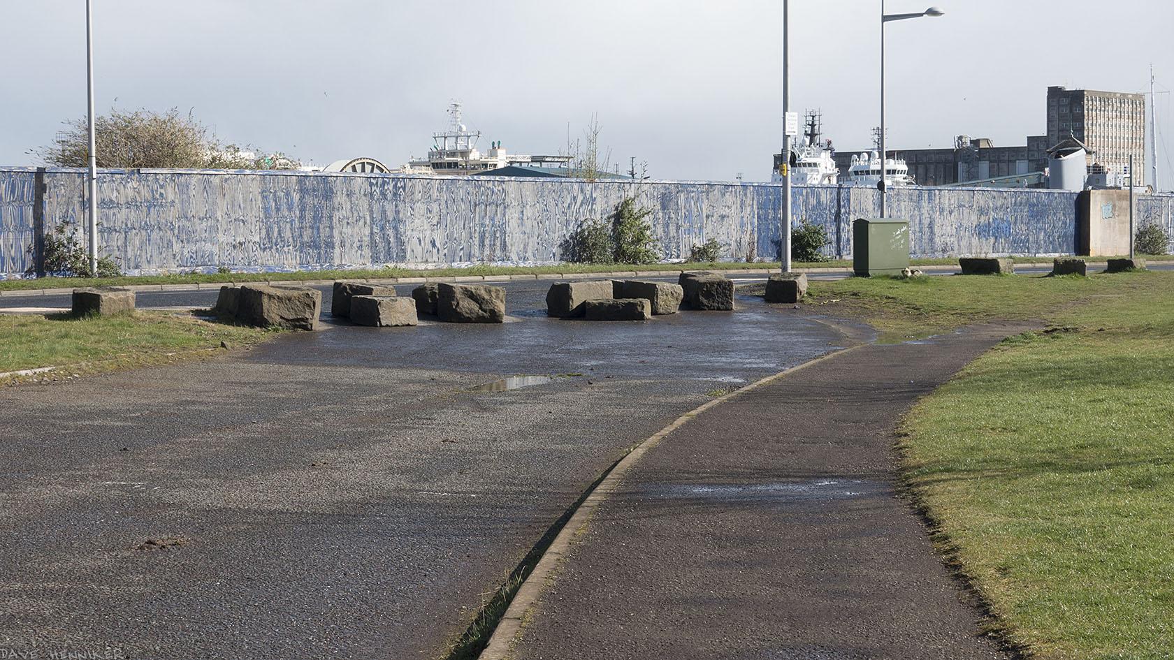 Ocean Drive ahead behind the stone blocks.