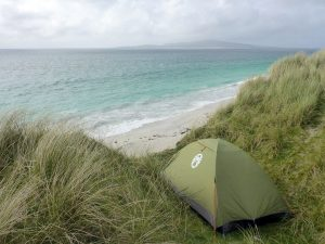 24 Tent in hollow, Pabbay in distance