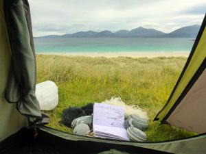 113 View from tent with stones & wool